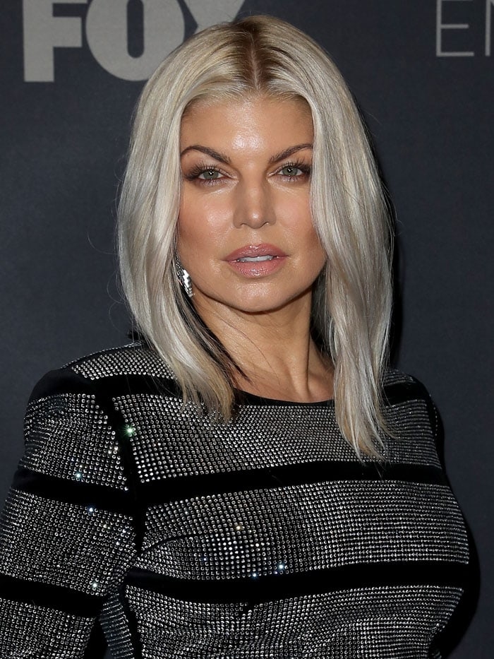 Fergie's platinum-blonde bob was also highlighted with black streaks at her nape
