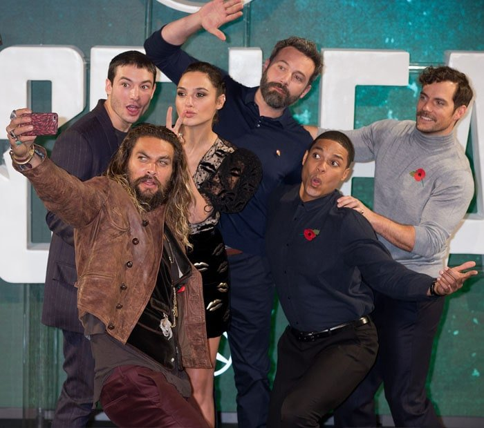 "Gal poses with the all-star cast of ""Justice League"""