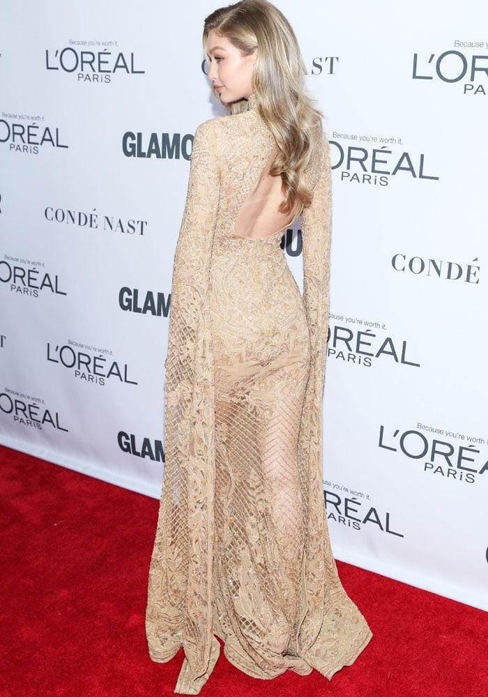 Gigi shows off her slender figure in the gold dress