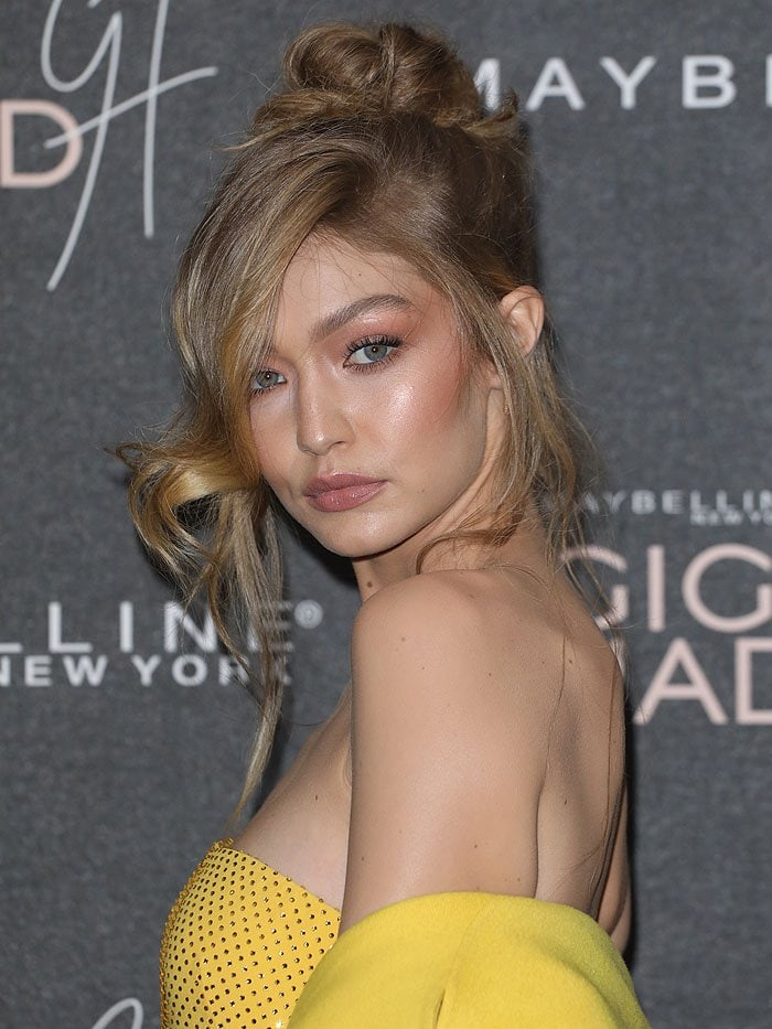 Gigi Hadid finished her belle-of-the-ball look with a messy, loose-wave updo and peach-toned makeup