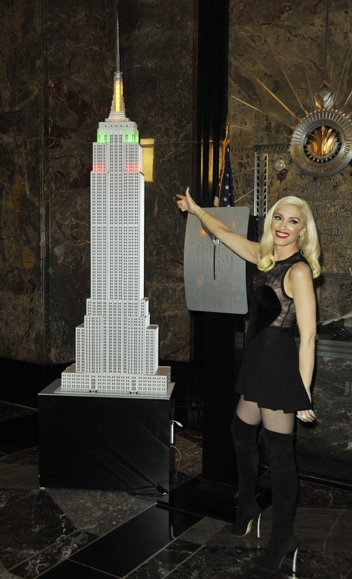 Gwen Stefani flips the switch at the Empire State Building's Symbolic Lighting Ceremony to promote the 2017 Holiday Light Show in New York City on November 20, 2017