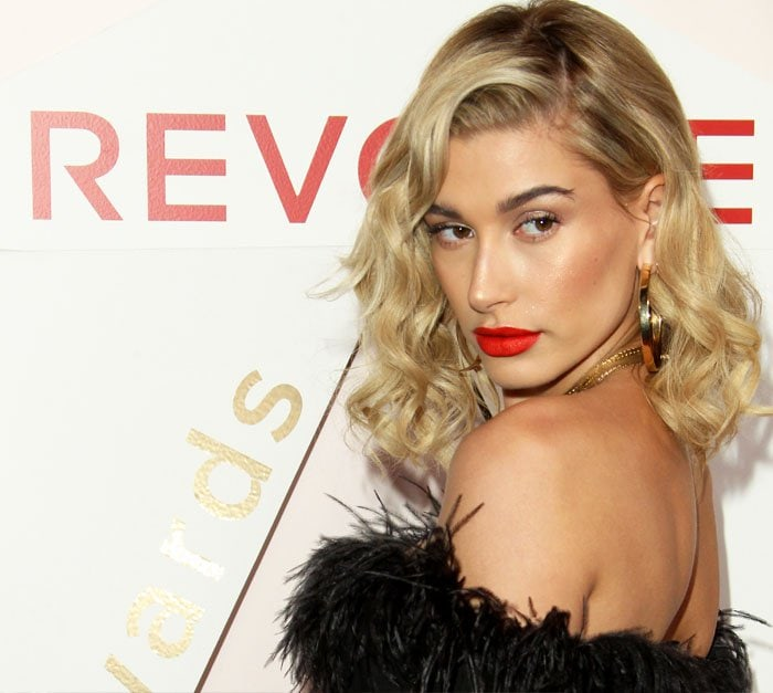Hailey was all about the bronzer and red lips for the night