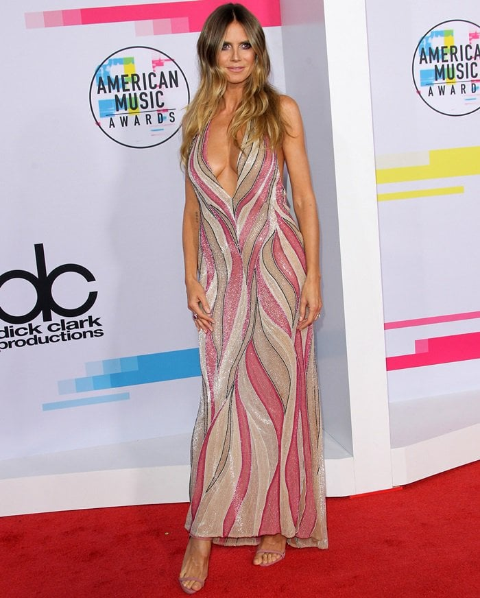 Heidi Klum in a vintage Gianni Versace dress at the 2017 American Music Awards held at the Microsoft Theater in Los Angeles on November 19, 2017