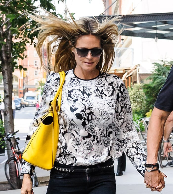 "Heidi Klum toting a large yellow ""Miranda"" tote from Michael Kors"