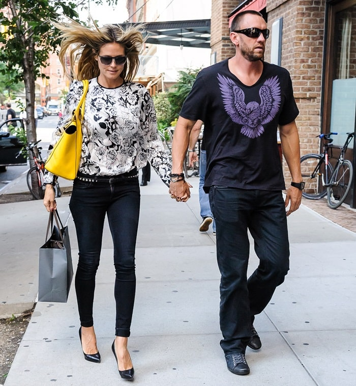Heidi Klum and boyfriend Martin Kristen return to their hotel after a spot of shopping in SoHo on June 11, 2013