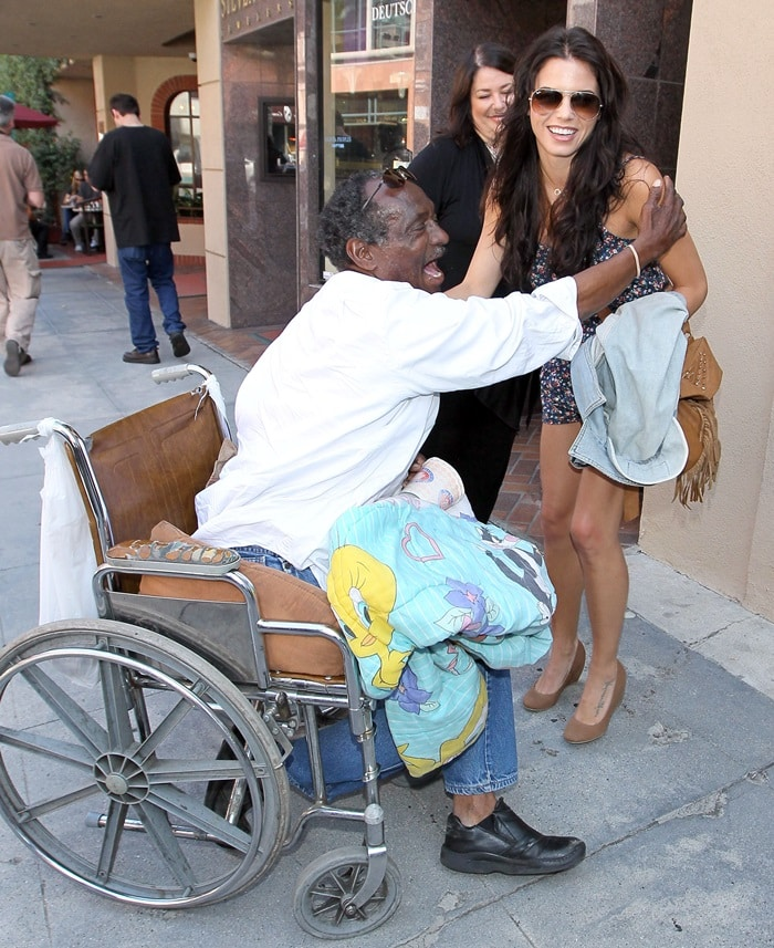 Jenna Dewan, Channing Tatum's girlfriend, shows her generosity by giving money and a hug to a homeless man in a wheelchair after having lunch at Judi's Deli in Beverly Hills on June 28, 2010