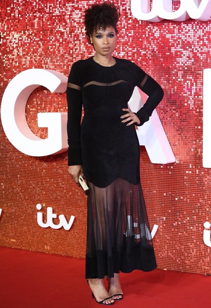 Jennifer Hudson flauntsher toned legs in a semi-sheer dress from Alexander McQueen