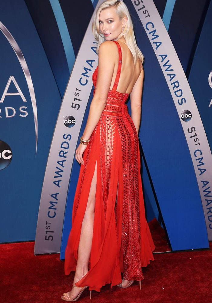 Karlie shows off the beautiful sheer panels of her embellished gown