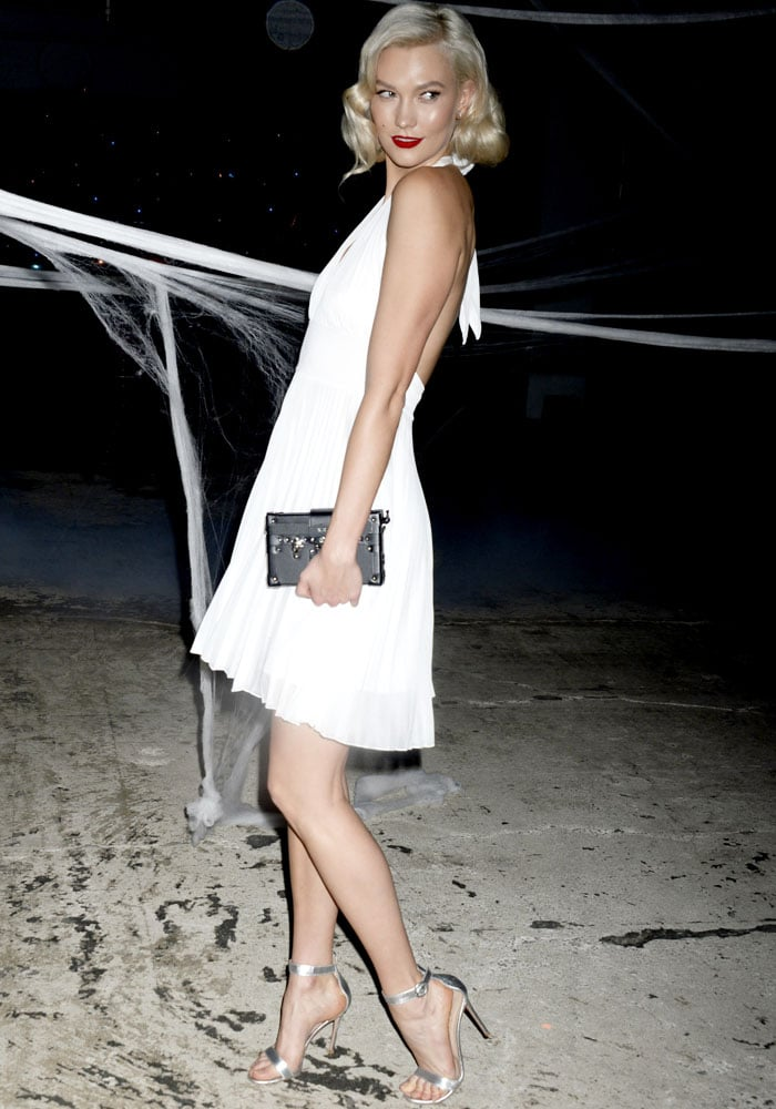 "Karlie pairs her look with the Louis Vuitton ""Petite Malle"" bag in Crocodile Brilliant"