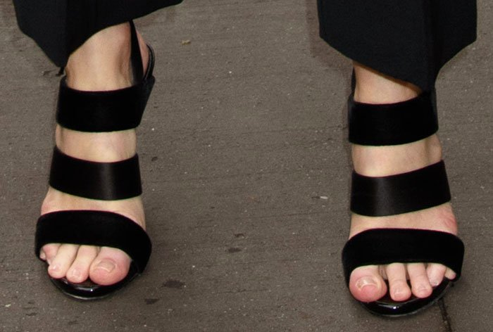Kate mixes satin and velvet with a pair of Giuseppe Zanotti strappy sandals