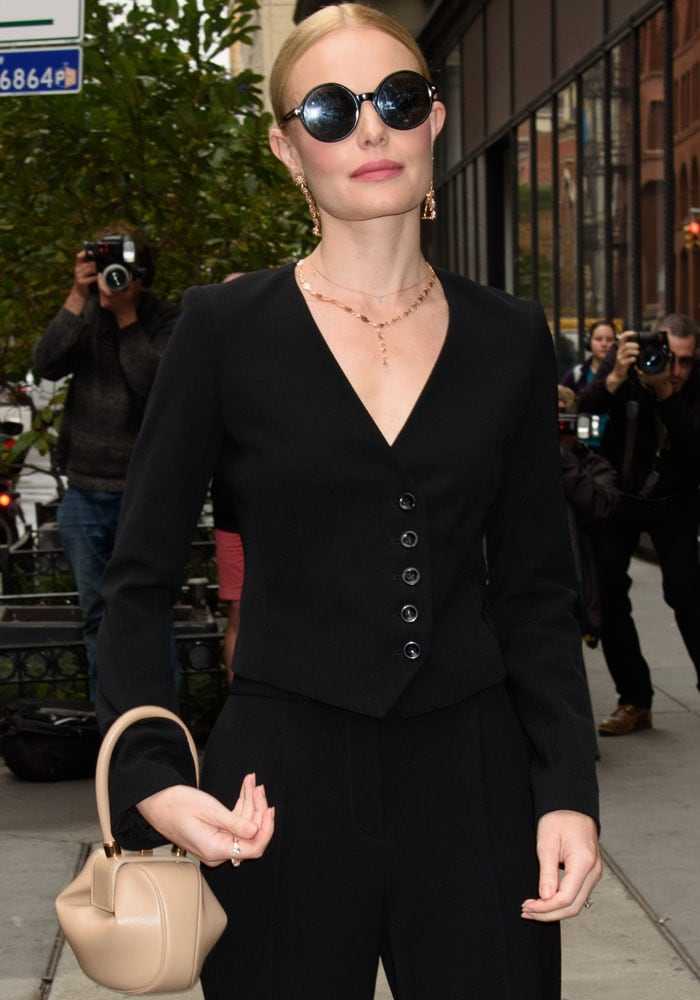 A pair of Alexander McQueen round sunglasses completes Kate's look