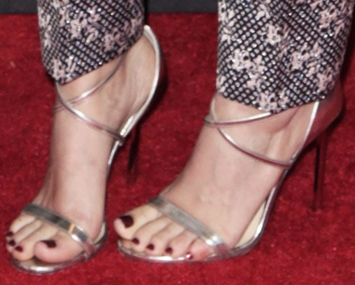 """Kate mirrors her suit's shine with a pair of Jimmy Choo """"Hesper"""" sandals in silver"""