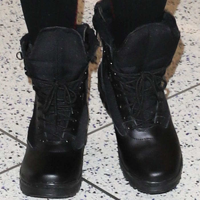 Khloe puts a pair of black combat boots under her list of travel footwear