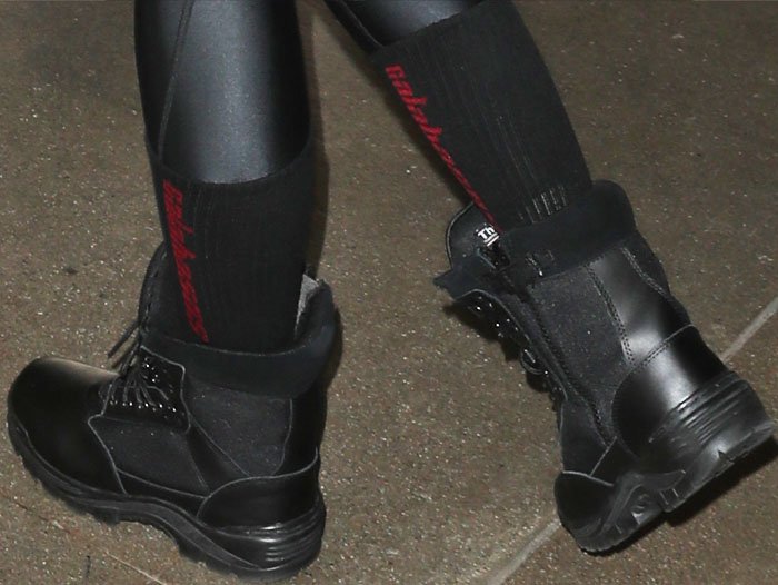 """Khloe wears a pair of Yeezy """"Calabasas"""" socks with her boots"""