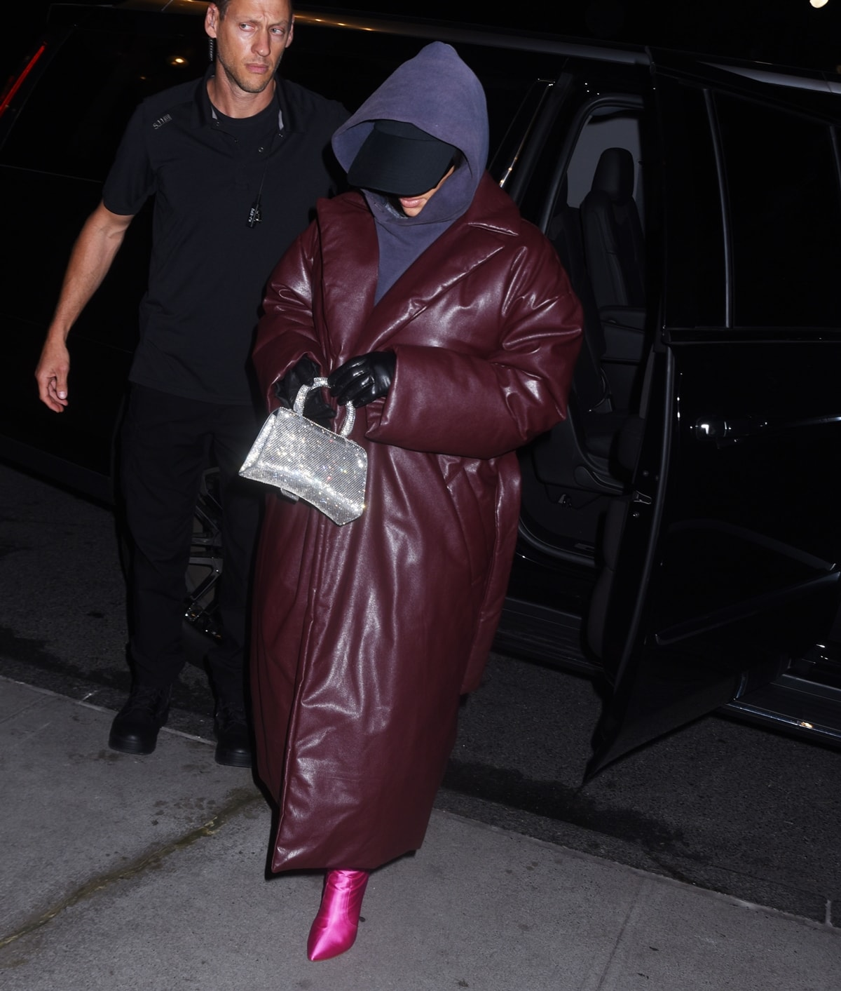 Kim Kardashian returns to her hotel in a padded leather Balenciaga coat after SNL rehearsals