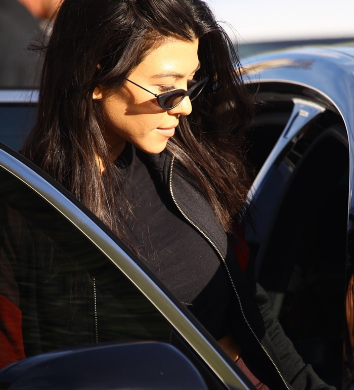 Kourtney Kardashian getting into her car