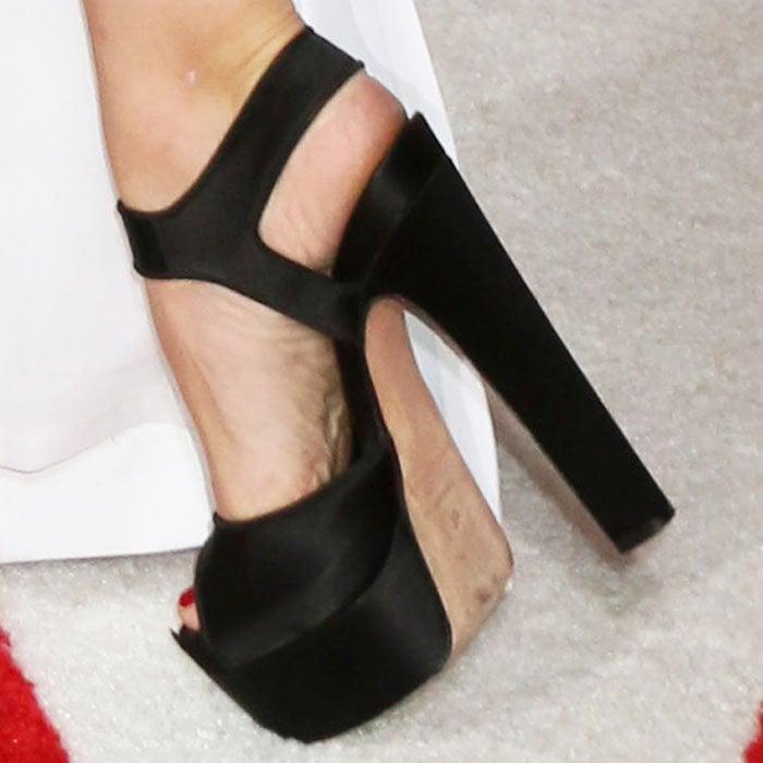 "Kristen shows off her towering Brian Atwood ""Karin"" platform sandals"