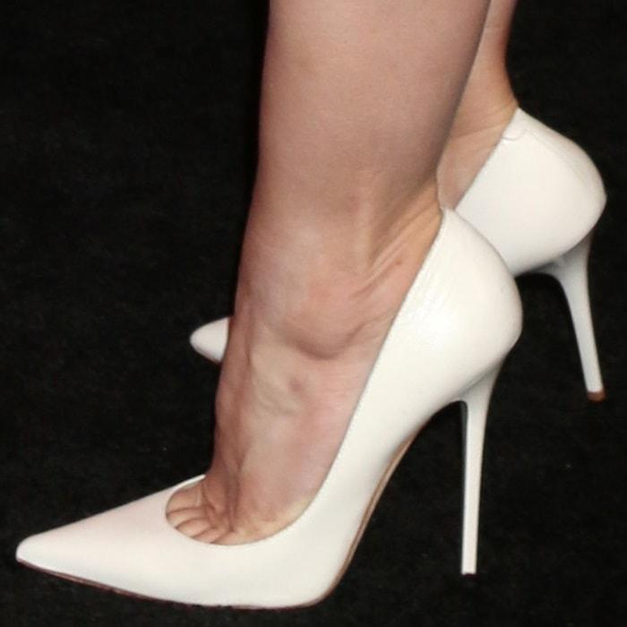 Kristen Bell wearing pointy-toe Jimmy Choo heels