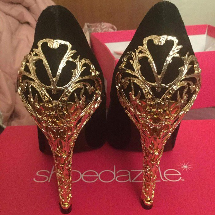 Her luxurious gold filigree heel is drool-worthy all on its own, but that velvet material just adds to her appeal