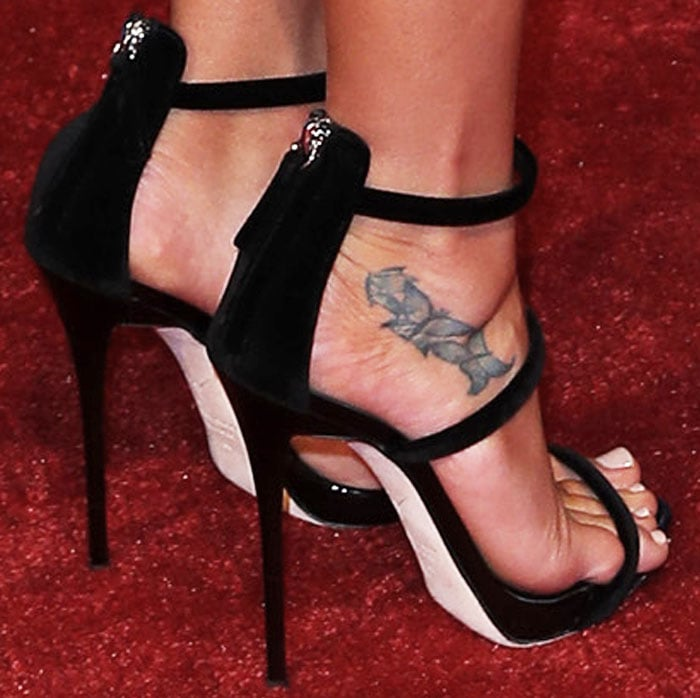 Lea Michele has butterfly tattoos on her right foot for her cousins