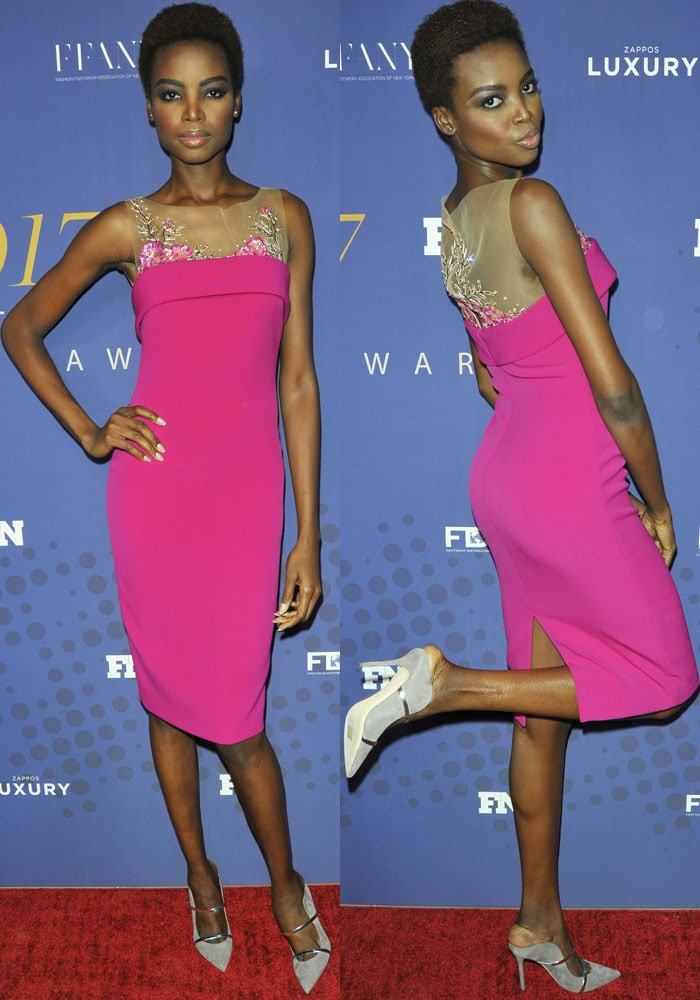 Maria turns heads in a bright pink dress by Badgley Mischka