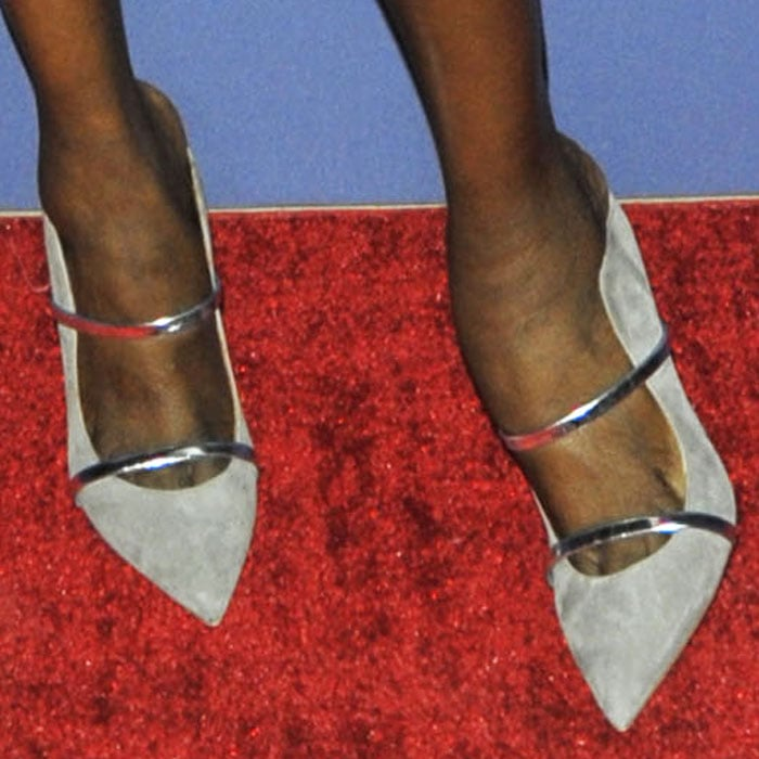 "Maria celebrates Malone Souliers by wearing their ""Maureen"" mules in gray suede"