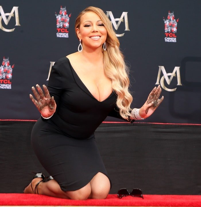 Mariah Carey donned a plunging black dress for her hand and footprint ceremony at the iconic Hand and Footprint Ceremony at TCL Chinese Theatre in Hollywood, California, on November 1, 2017