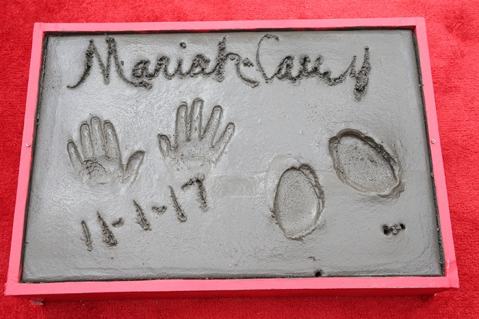 Mariah signed her name and dated the cement block that will be placed outside the famed TCL Chinese Theatre (formerly Grauman's Chinese Theatre)