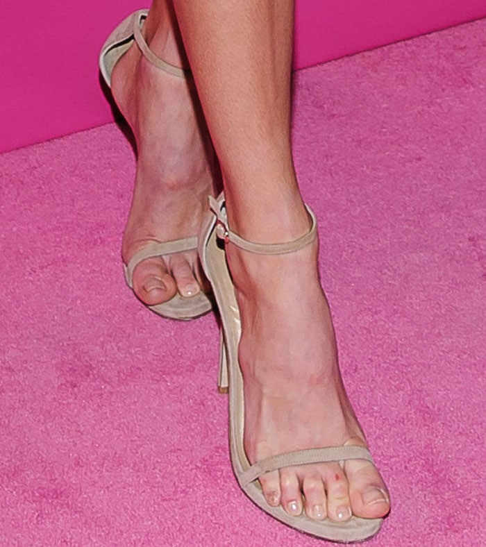 "The model turned to the classic Stuart Weitzman ""Nudist"" sandals to complete her look"