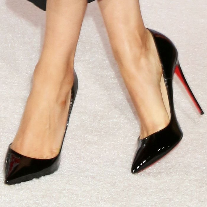 "Mila goes for the classic pump in a Christian Louboutin ""So Kate"" patent pair"