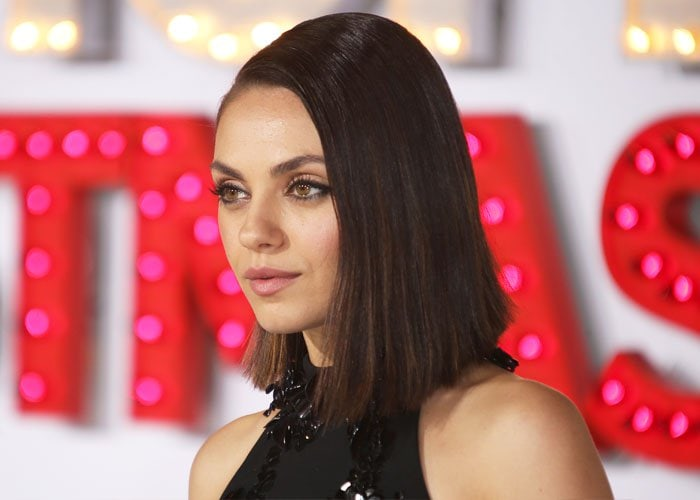 The beauty slicked her hair to one side