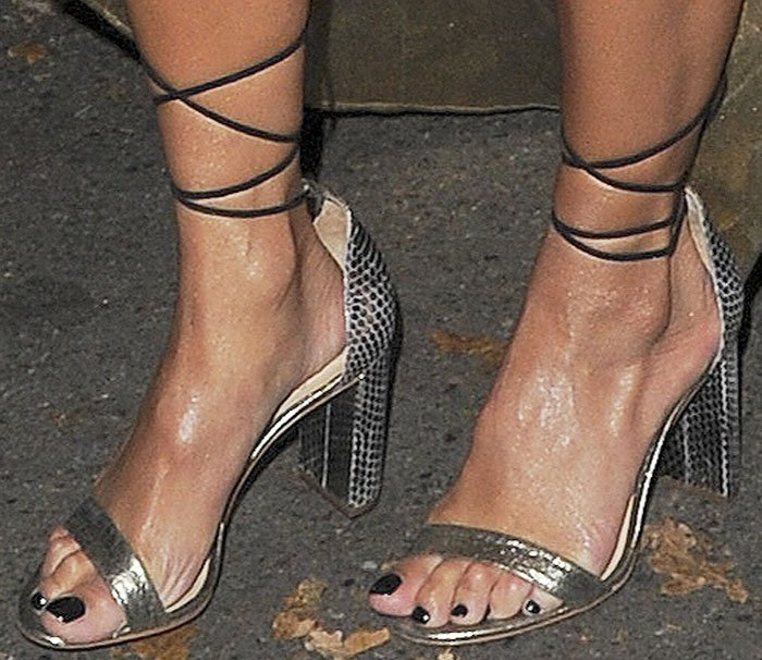 Nicole adds a modern touch to her Cleopatra look with lace-up Vince Camuto sandals