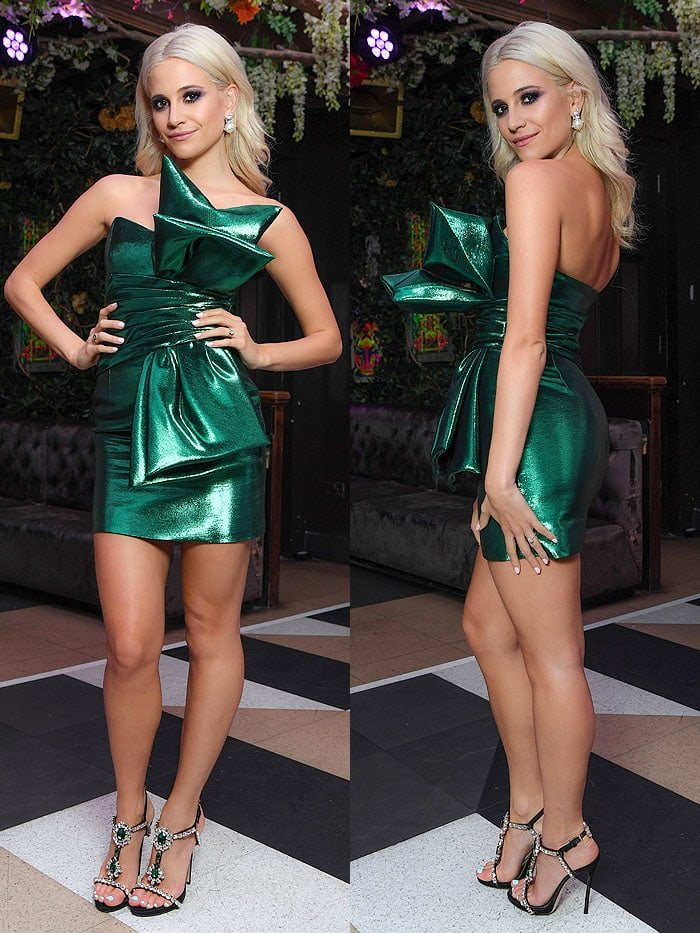 Sporting a shiny green Saint Laurent Fall 2016 strapless dress with a giant bow in front, Pixie Lott looked like a gaily wrapped present waiting to be opened under a Christmas tree