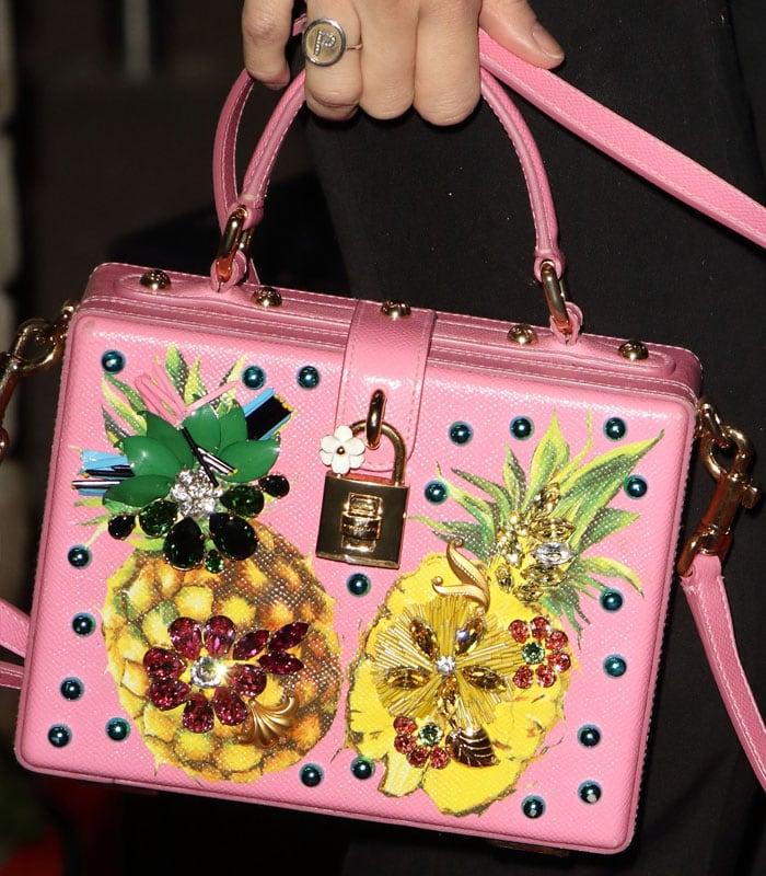 Details of Pixie Lott's pink Dolce & Gabbana embellishedpineapple handbag.