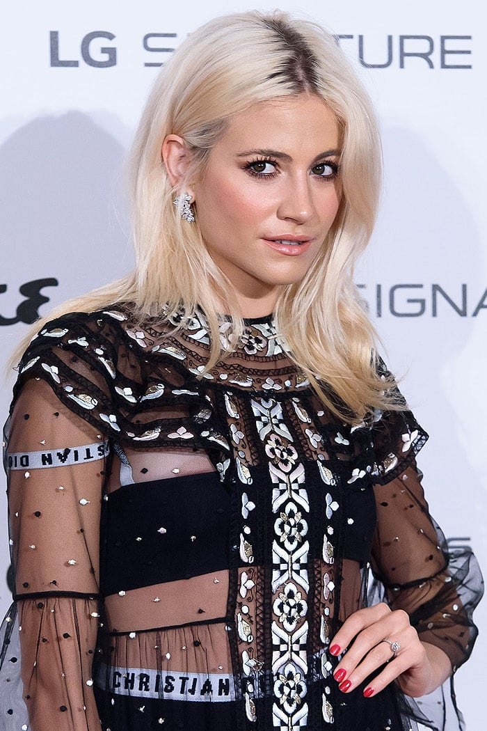 Peek a boob! Pixie Lott accidentally exposing a nipple in her Christian Dior pre-fall 2017 sheer embroidered dress worn with Dior logo bandeau top and boxer shorts.