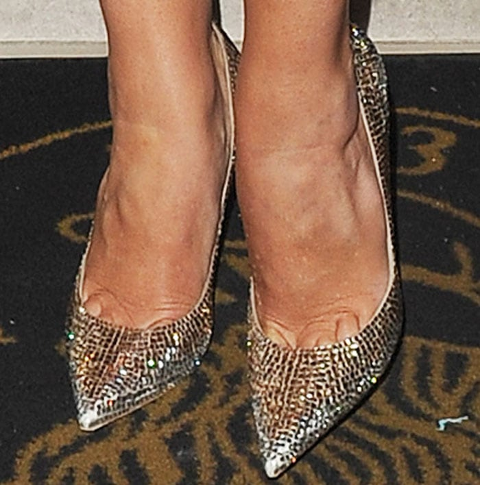 "Rosie adds a little sparkle with a pair of Jimmy Choo ""Romy"" pumps"