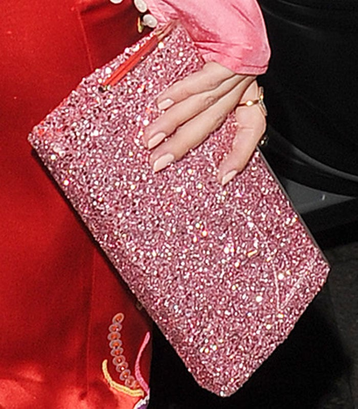 Rosie ushered in the holidays with a glitter clutch by Jimmy Choo