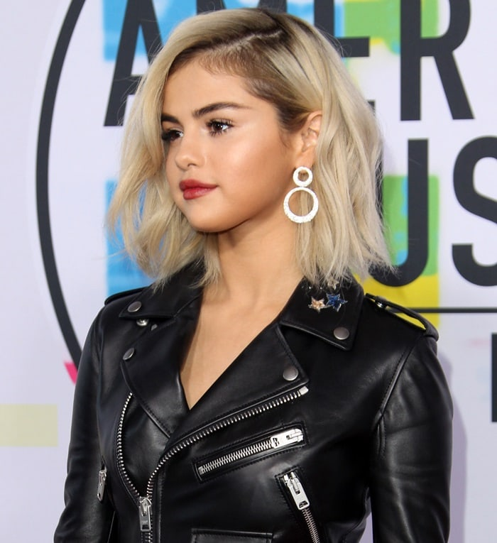 Selena Gomez in a Coach mini leather dress at the 2017 American Music Awards held at the Microsoft Theater in Los Angeles on November 19, 2017