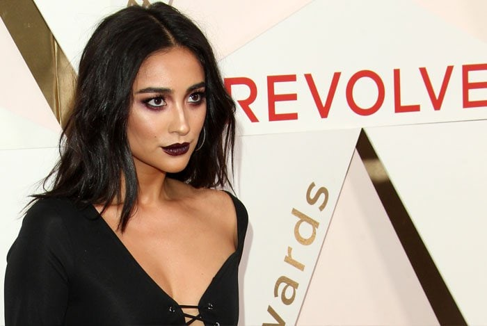 Shay goes for dark makeup to match her all-black outfit