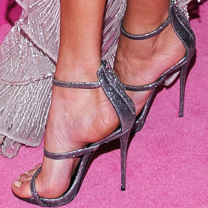 "A pair of Giuseppe Zanotti ""Harmony"" sandals complemented her dress"