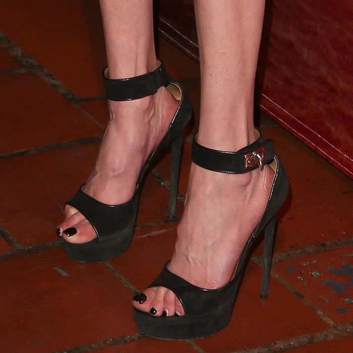 Closeup of Tara Reid's Givenchy 'Shark Lock' platform sandals.