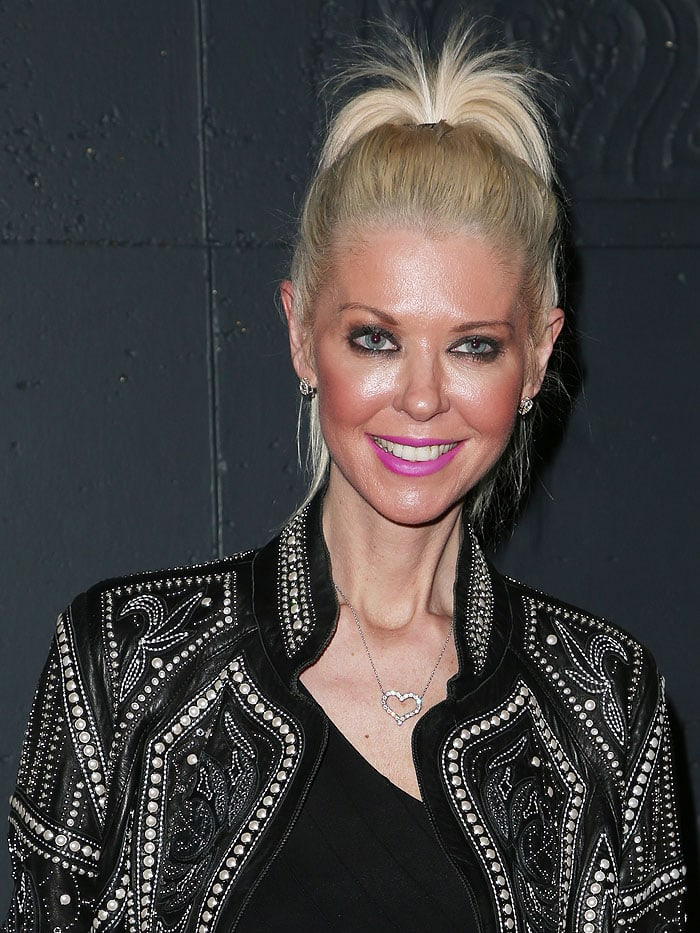 Tara Reid Bares Midriff In Dated Low Rise Jeans And