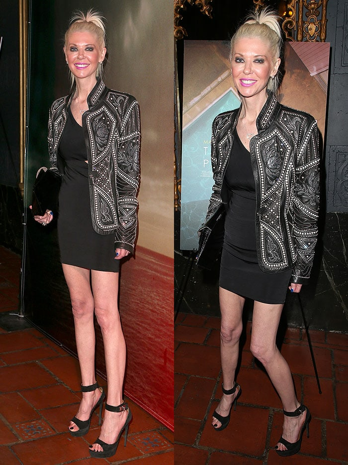 Tara Reid flaunted her long legs in a cutout-waist little black dress with a stunning black embellished leather jacket by For the Stars Fashion House by designer Jacob