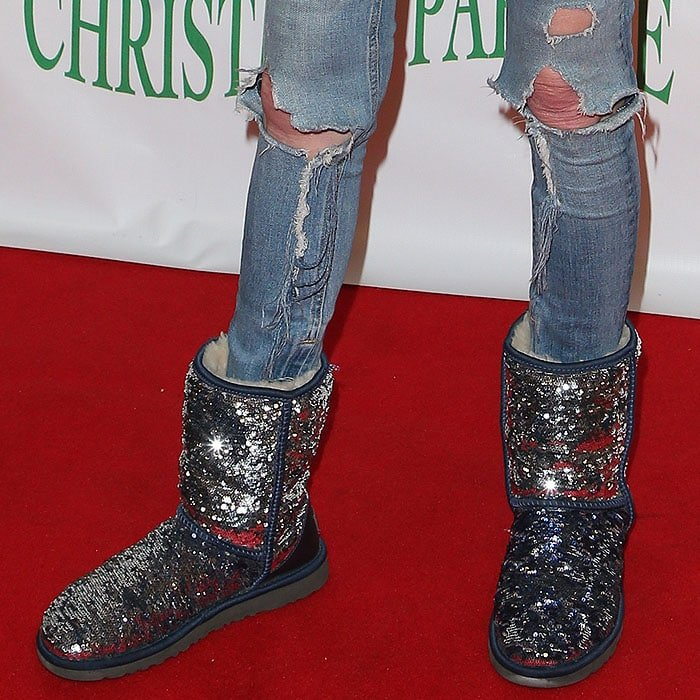 Details of Tara Reid'sUGG classic short 'Sparkle' boots with double-sided blue-and-sliver sequins and cream sheepskin fleece lining.