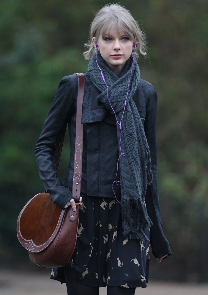 Taylor Swift toting a brown 'Rugby' pony hair saddle bag from Ralph Lauren