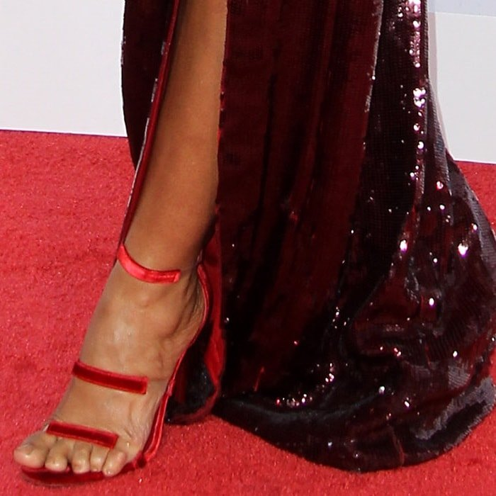 Tracee Ellis Ross torturing her feet in red three-strap 'Frontline' stiletto sandals by Tamara Mellon