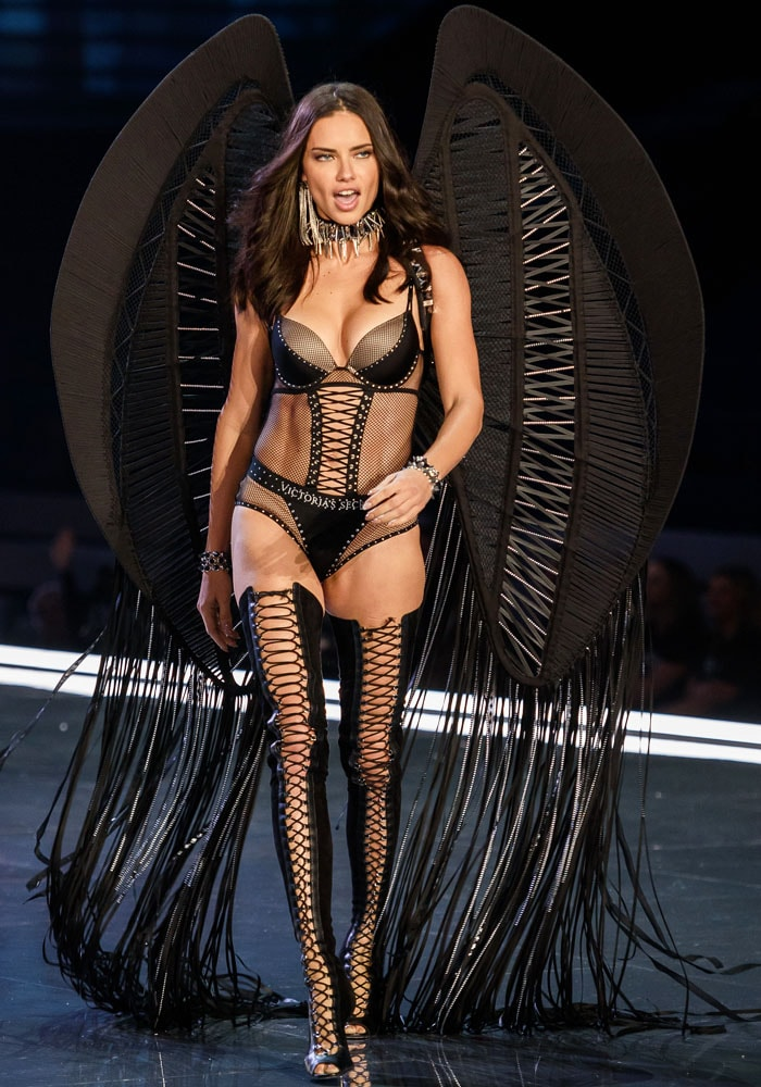 Legendary Angel Adriana Lima flutters her fringed wings in a barely there bodysuit