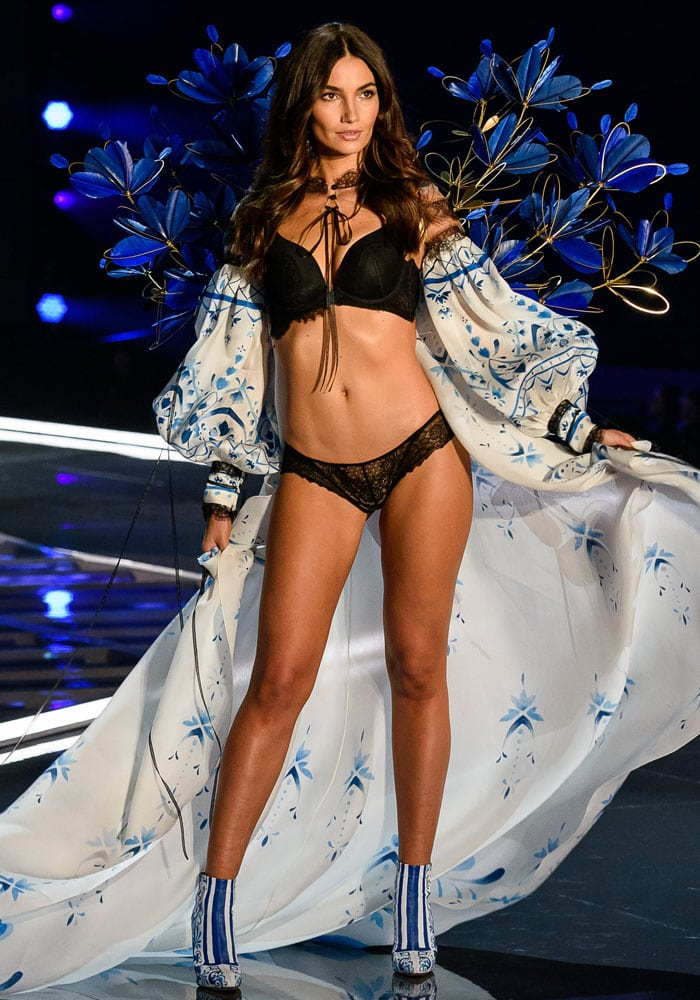 Lily Aldridge sports an elaborate pair of feather and metal wings with a flowy cover up