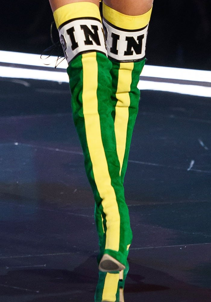 The thigh high boots also come in a green-and-yellow suede version