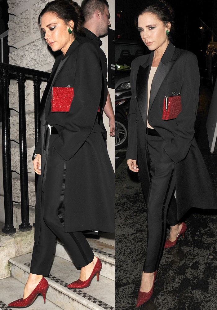 Victoria matches her shoes to her ruby red pocket clutch
